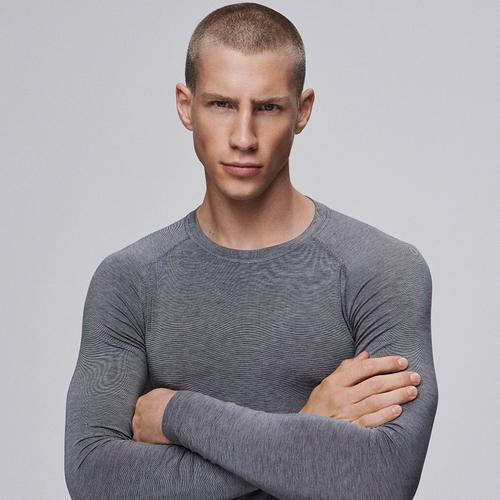 A male model in a gray thermal long sleeve top