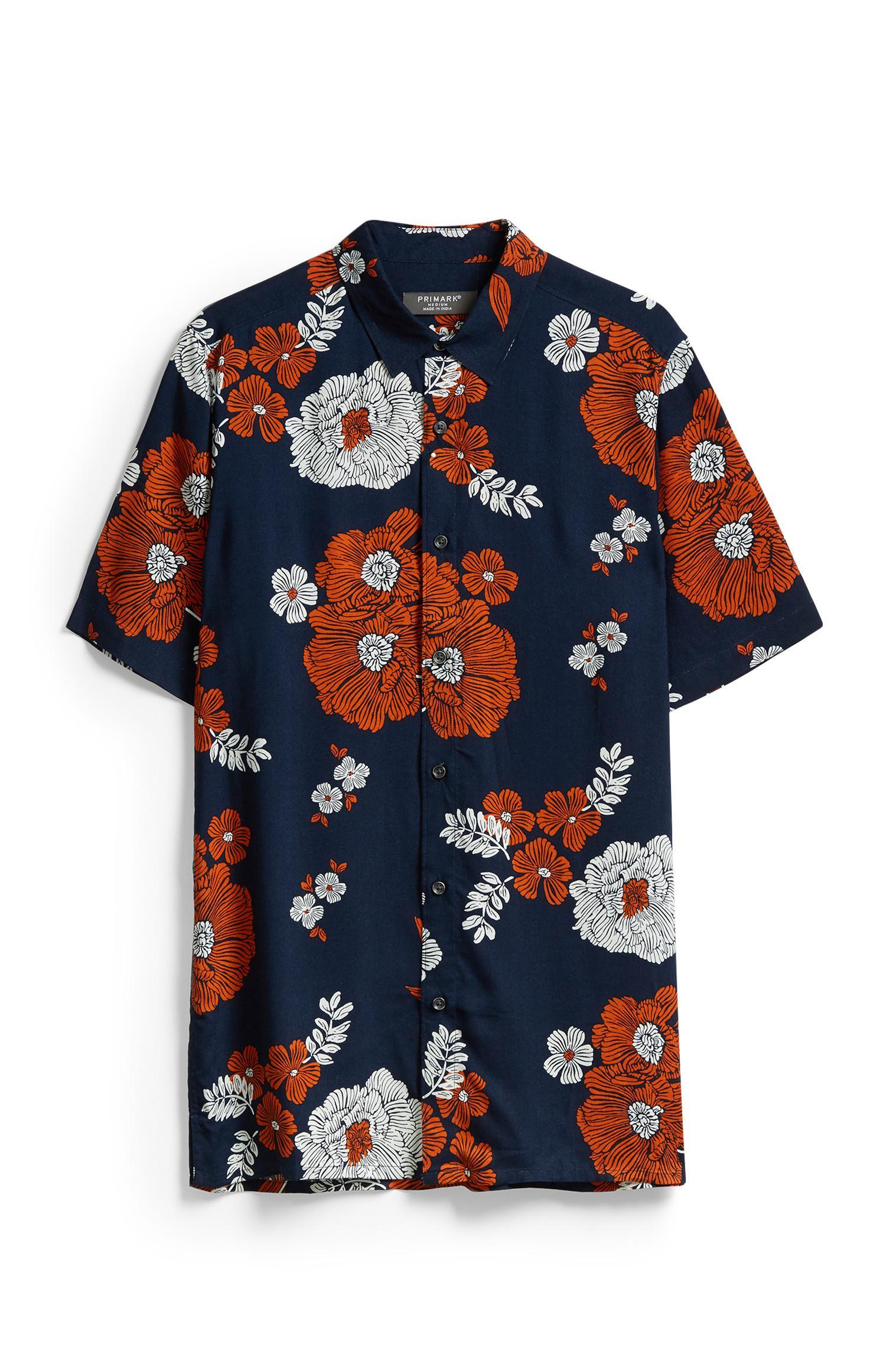 Marineblauw en oranje gebloemd overhemd