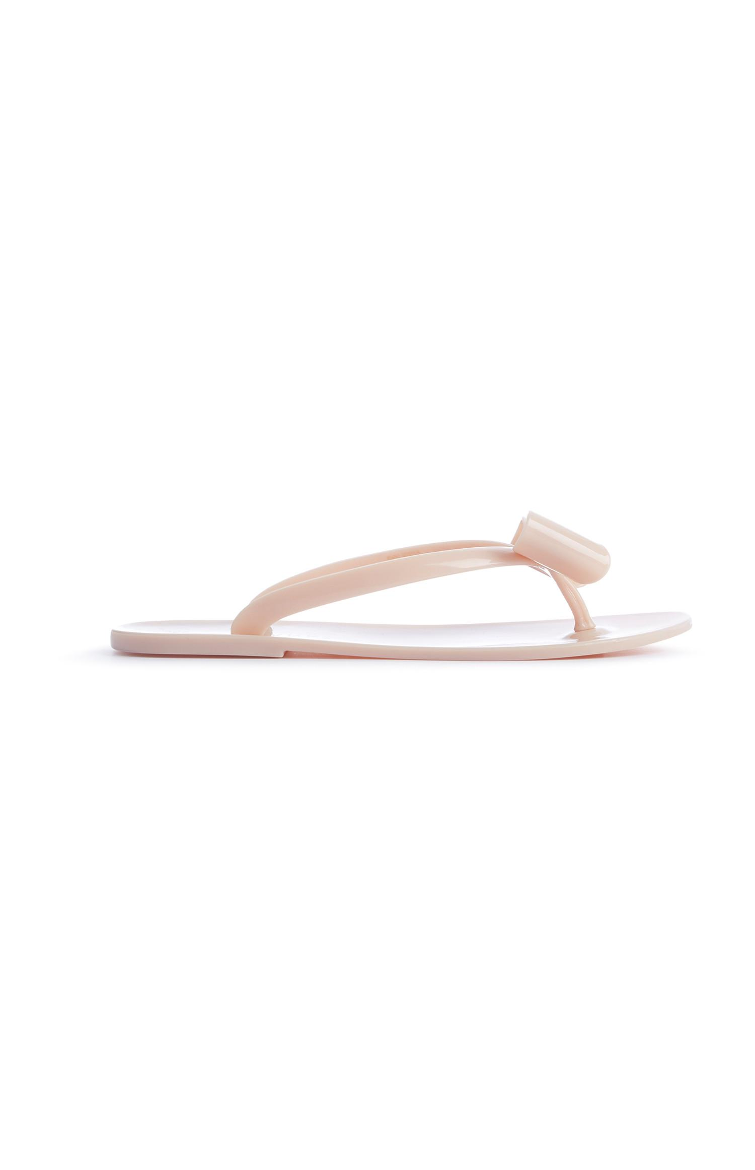 Chanclas de goma color nude con lazo