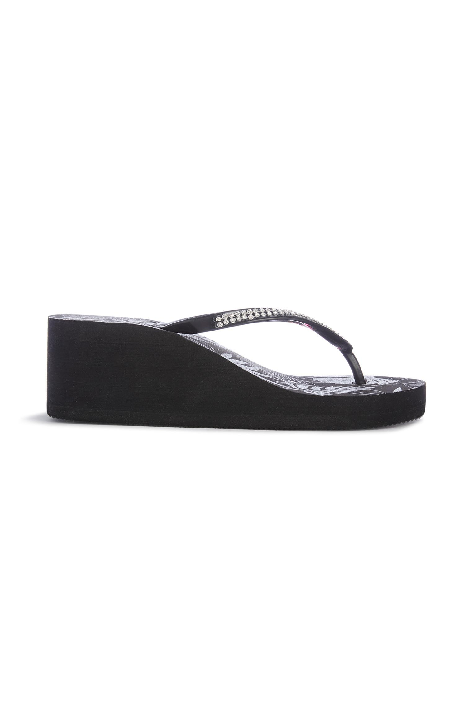 Schwarze Wedge-Flipflops