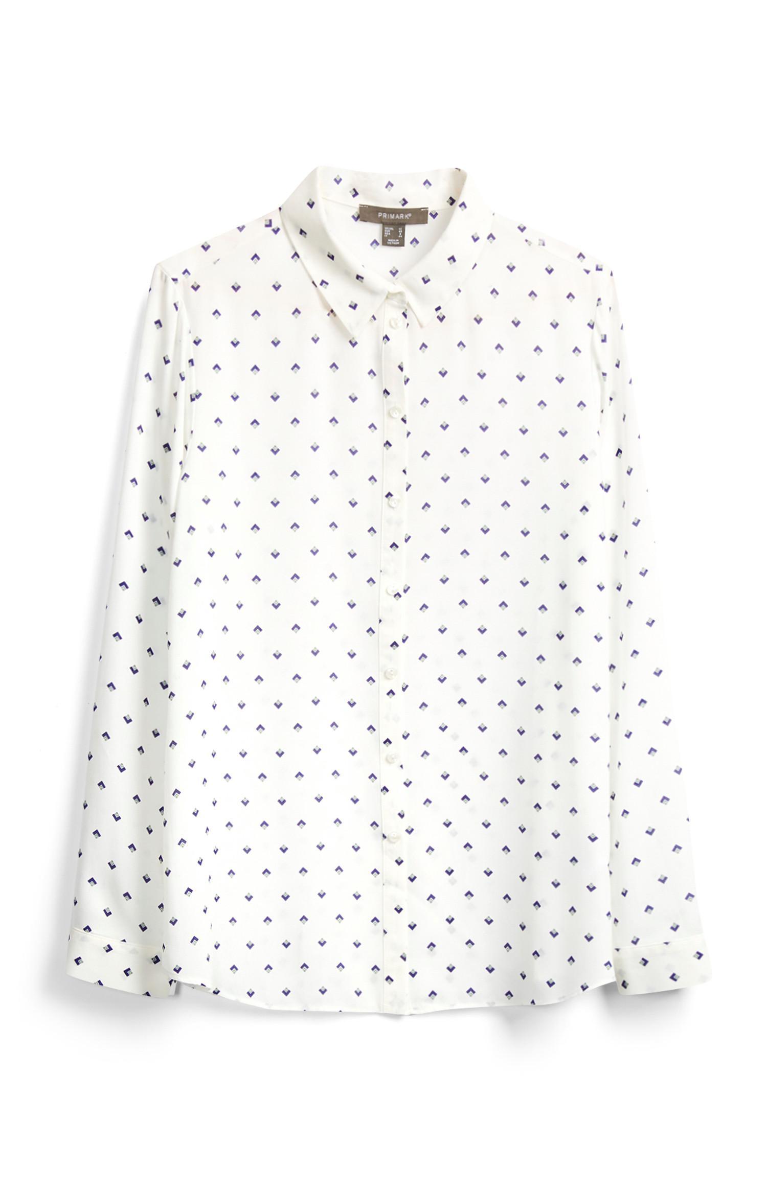 Blusa bianca con applicazioni