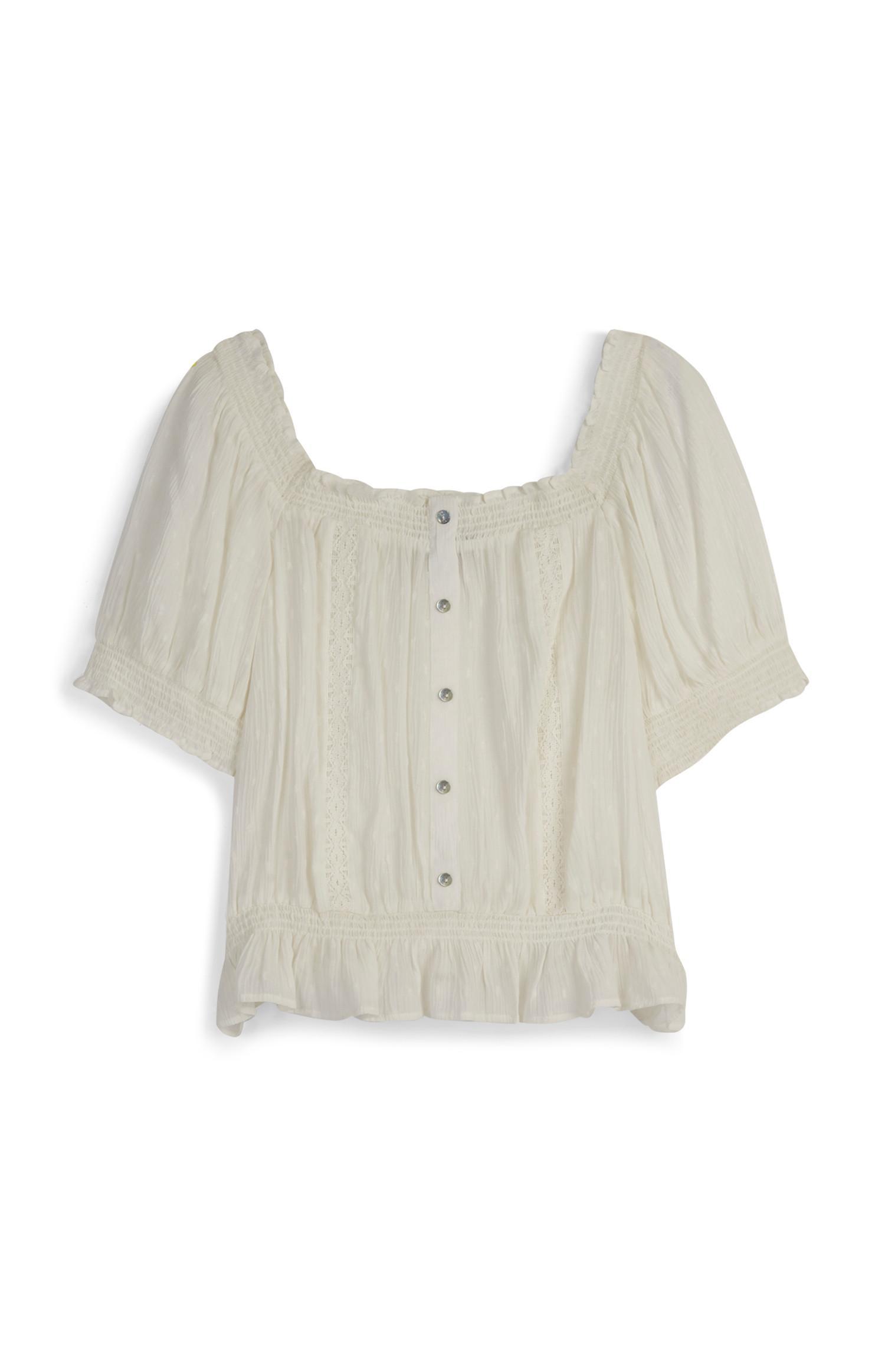 Ivoorwitte blouse met kanten details