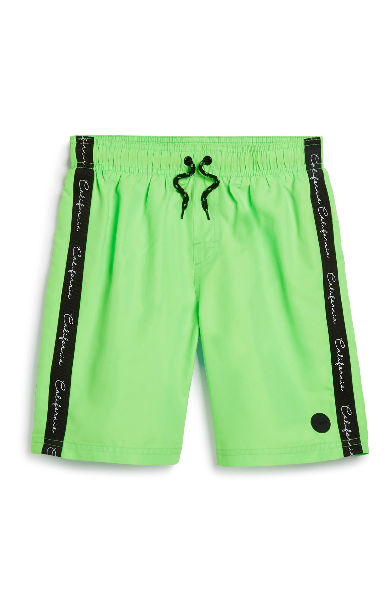 Older Boy Taped Green Swim Short