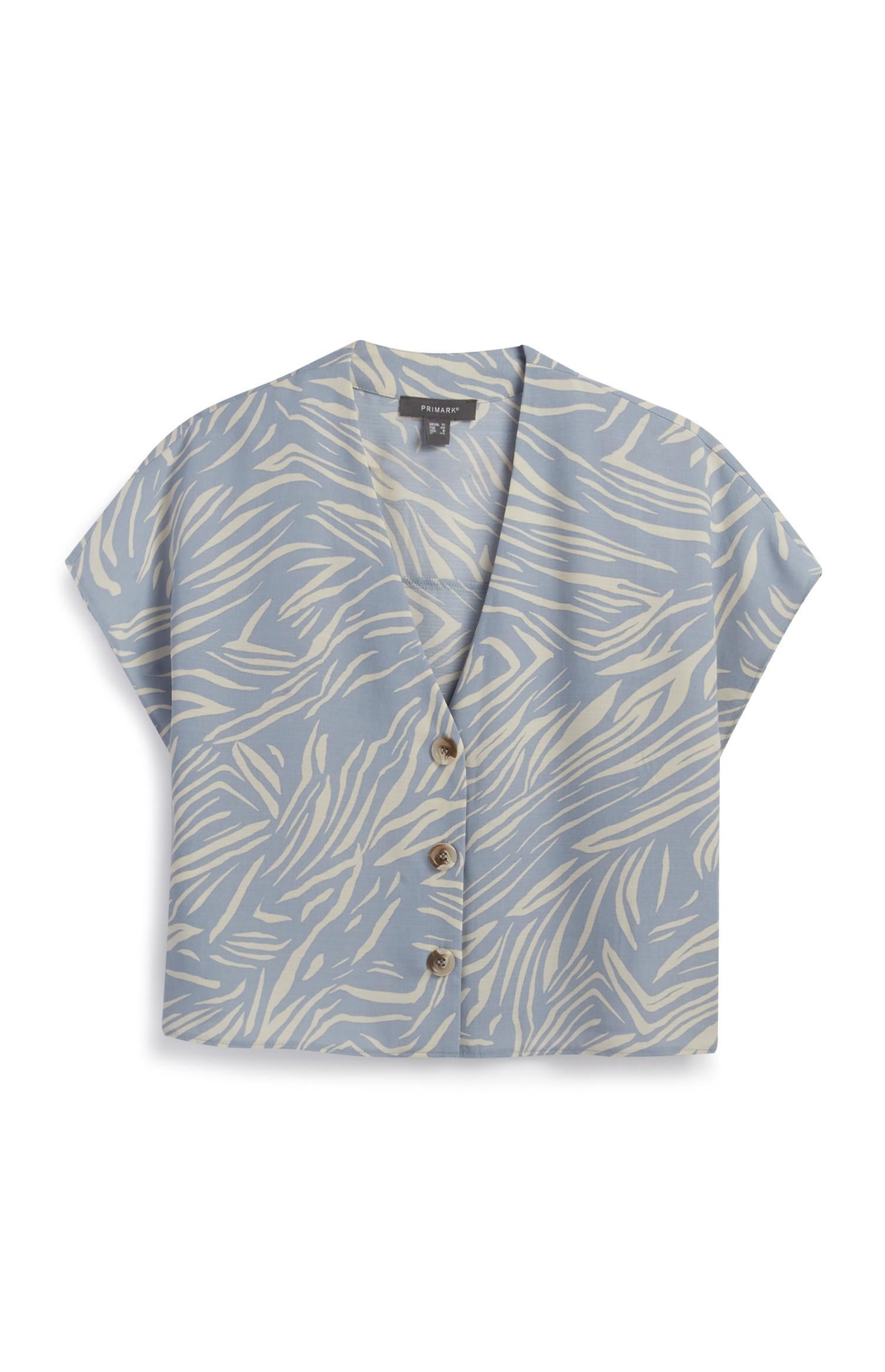 Blau gemusterte, kurze Bluse