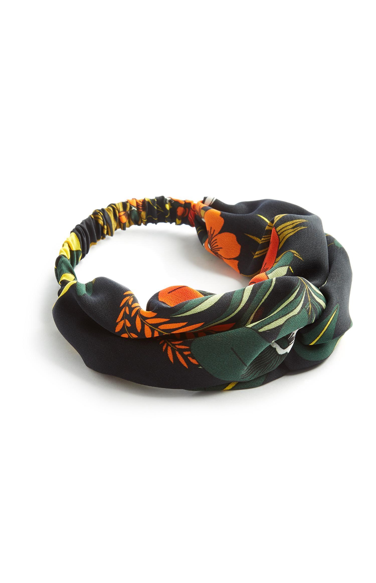 Zwarte hoofdband met bladerprint