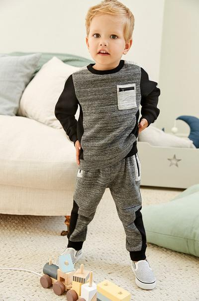toddler in tracksuit