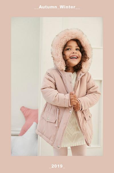 girl in pink coat