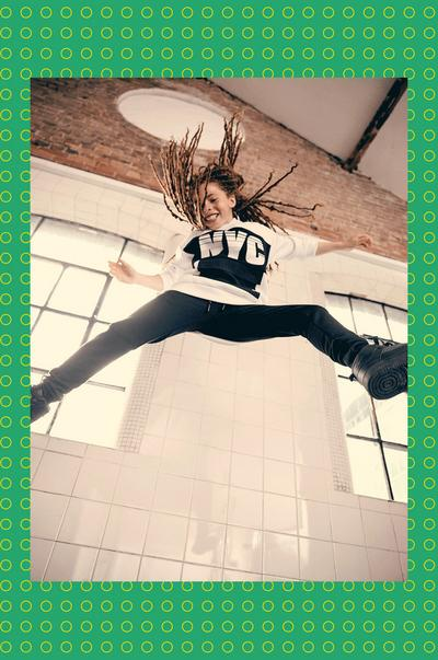Model jumping wearing Black-and-White NYC Hoodie