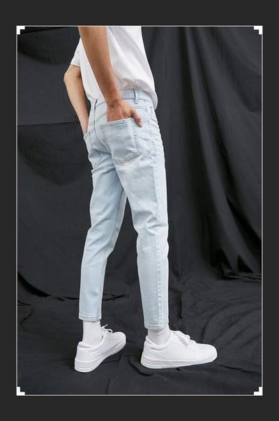 Model wearing light wash sustainable cotton jean