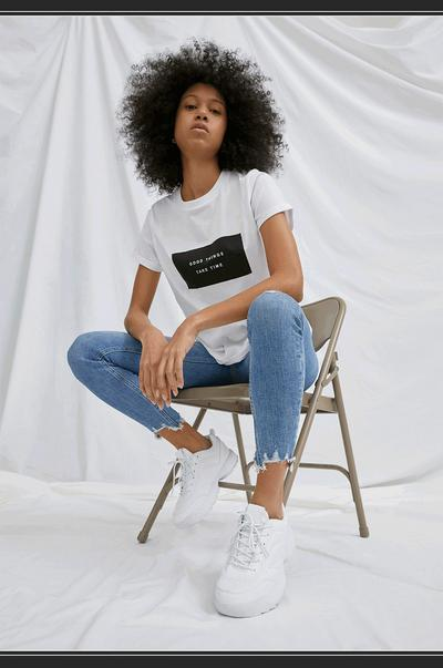 Moving image of model wearing sustainable cotton jean and t-shirt