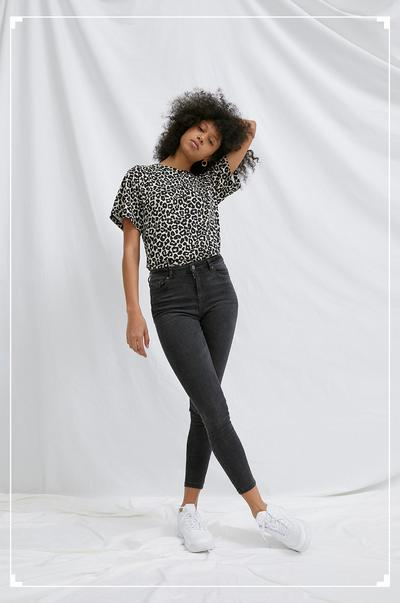 Model wearing leopard top and sustainable jean
