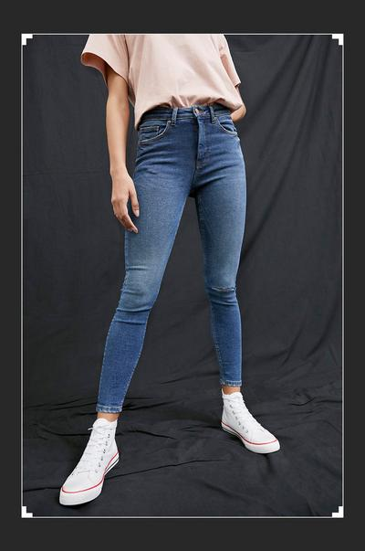 Girl wearing blue denim jeans