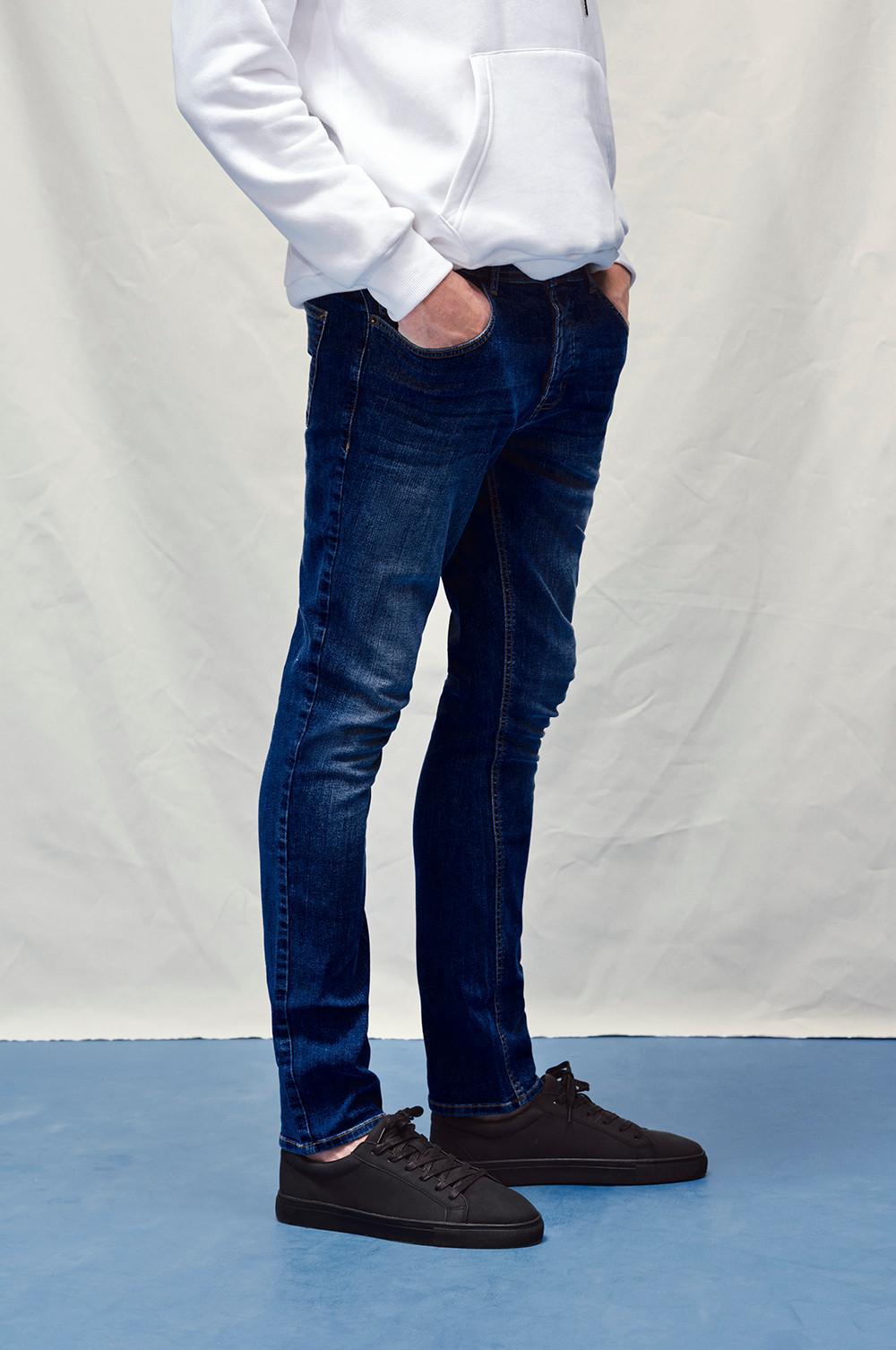 Model wearing The Slim Jean