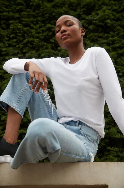 white top blue jeans