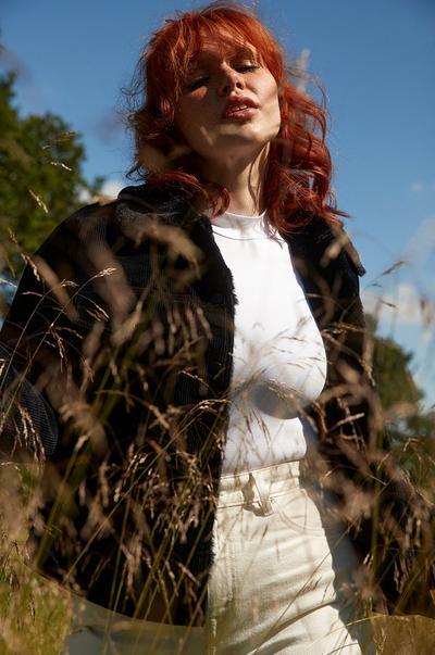 Model in cord jacket