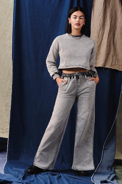 Model wearing Soft Grey Denim Sweatshirt and Trousers