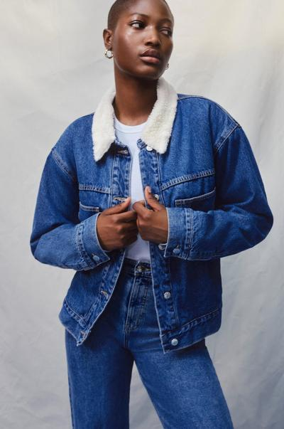 Model wearing borg denim jacket and jeans