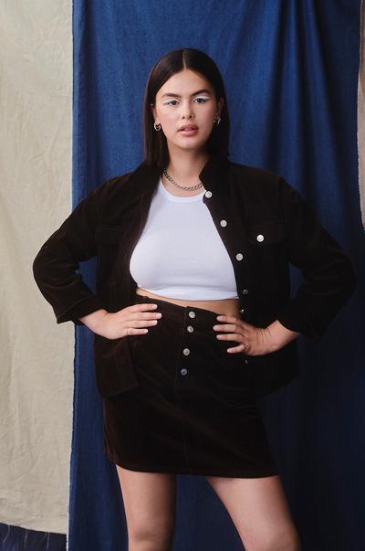 Model wearing Cord Shacket and Cord Mini Skirt