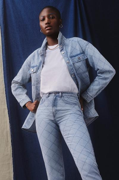Model wearing quilted denim jeans