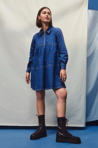 Model wearing Denim Smock Dress