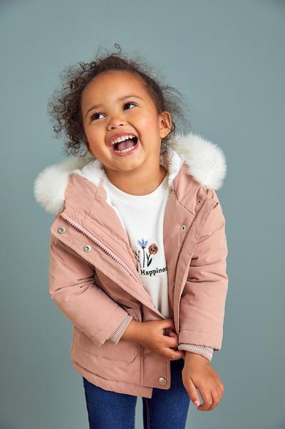 Model wearing pink coat