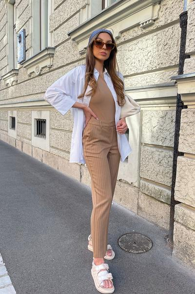 Model wearing neutral tailoring and sunglasses full size