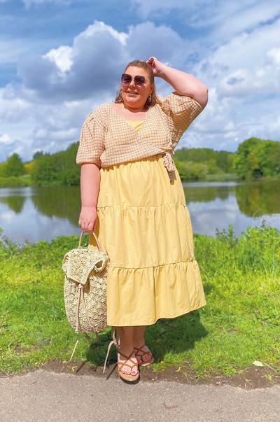 Model wearing bright yellow maxi dress