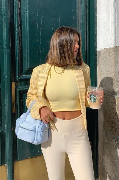 Model wearing yellow seamless separates