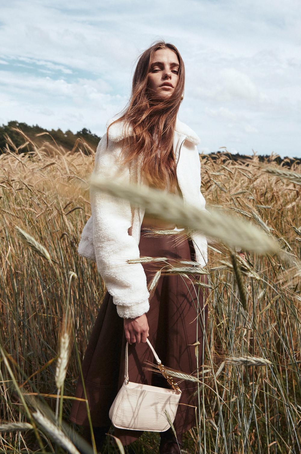 model in borg coat