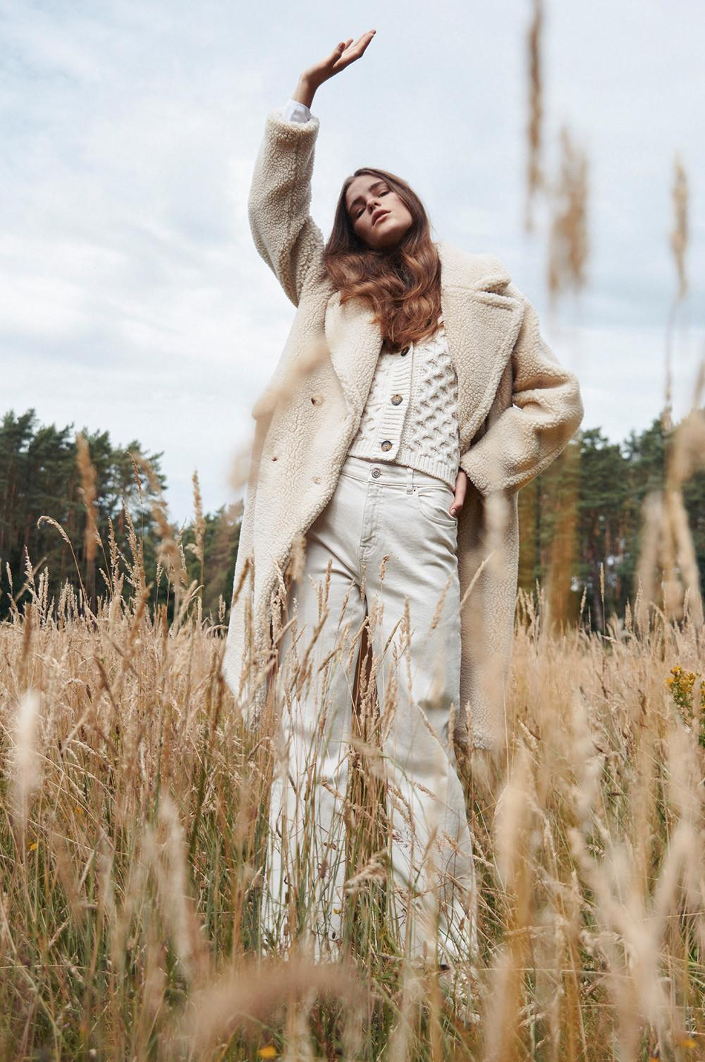 Model in field wearing cream