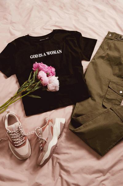 black t-shirt and khaki trousers