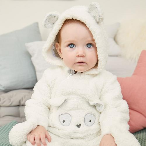 Baby in white bear snuggle suit