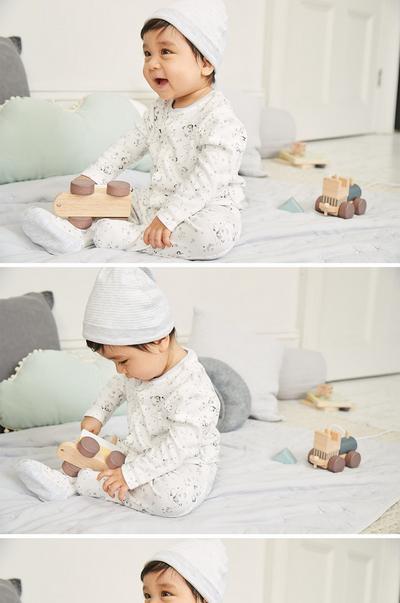 Baby in white panda onesie