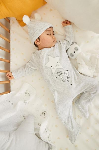 Baby in star sleeper and hat