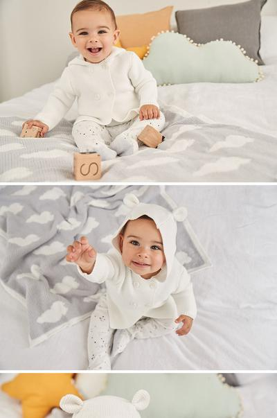 Baby in hooded cardigan and leggings