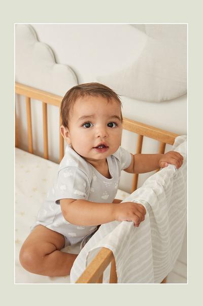 Baby in gray onesie