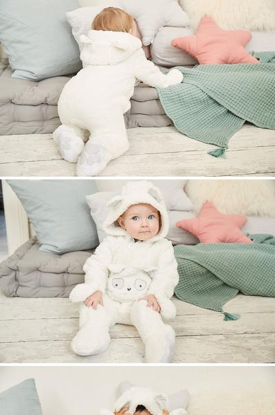 Baby wearing bear snuggle suit