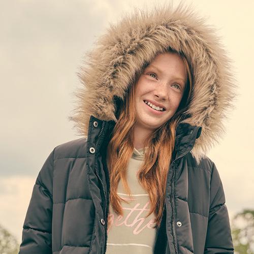 Model wearing Black Padded Jacket with Brown Hood