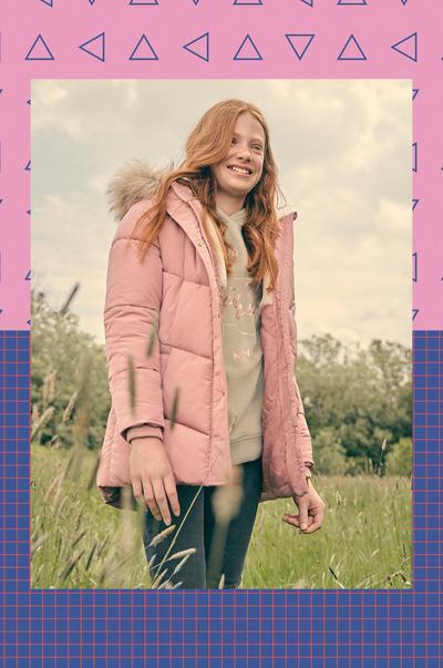 Model wearing pink belted puffer jacket