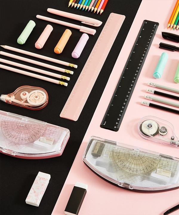 Black and pink stationery flat lay image