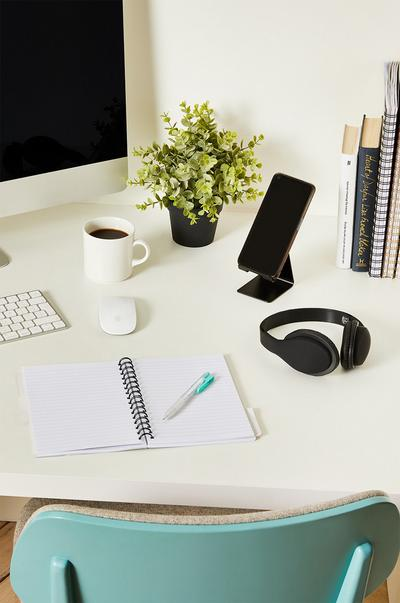 Headphones and tech accessories on a desk