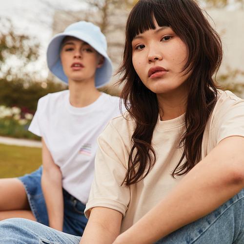 Models wearing summer T-shirts and denim