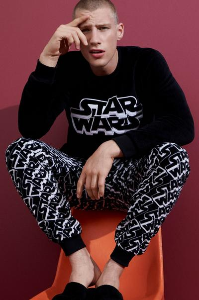 Male in Star Wars pajamas