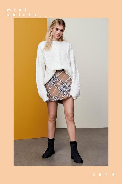 Woman in check skirt