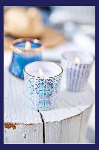 Blue glass candle