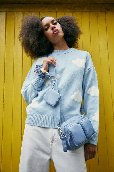 Model wearing Blue Cloud Print Jumper