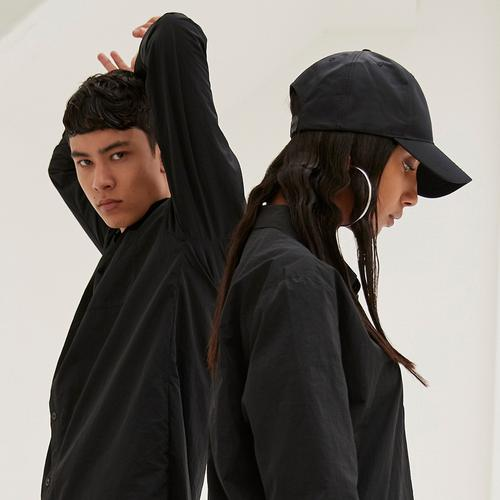 Models wearing black Primark streetwear clothing