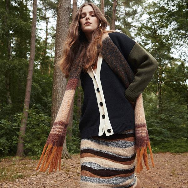 model wears striped dress