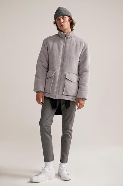 Model wearing grey coat