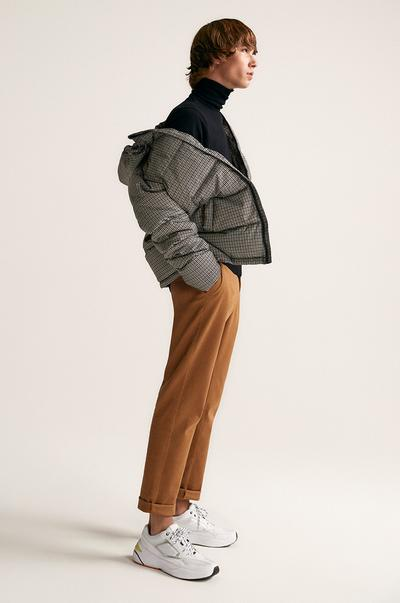 Model wearing chinos and a puffer jacket